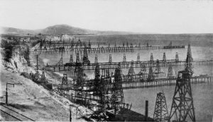 Photo of Piers with California's first offshore oil wells, Summerland Field, before 1906