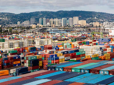 Photo of the Port of Oakland in front of the City Skyline, courtesy of the Port of Oakland